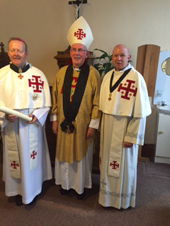 Admission of archbishop Eamon Martin. L to r Archbishop Martin grand Prior Sean Cardinal Brady and Vy Rev Derek Darby